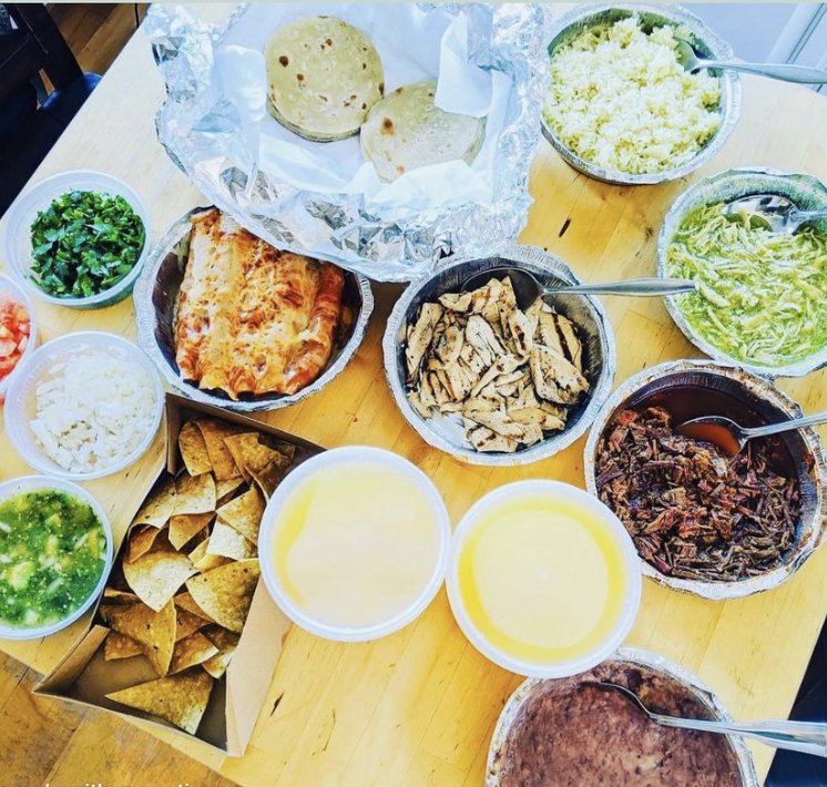 Overhead image of taco bar take out family meal.