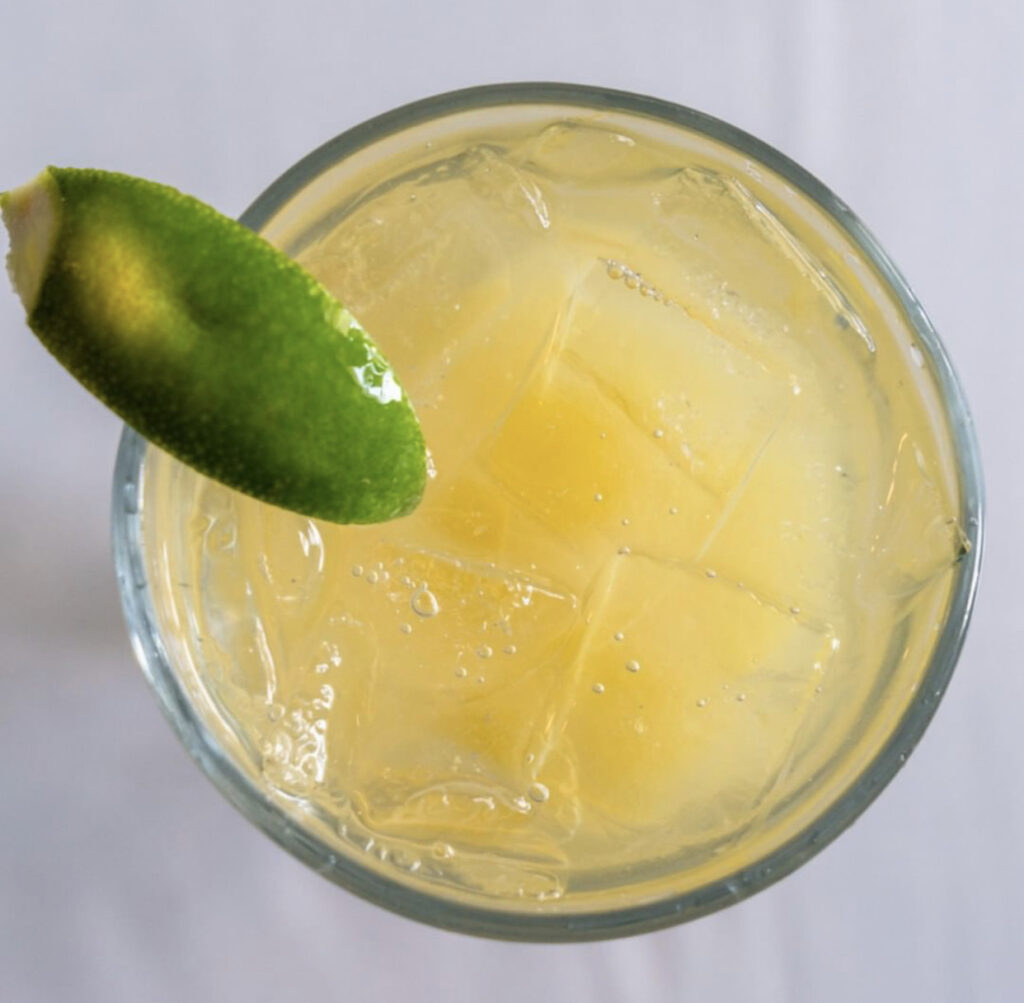 Overhead pictures of a margarita with a lime