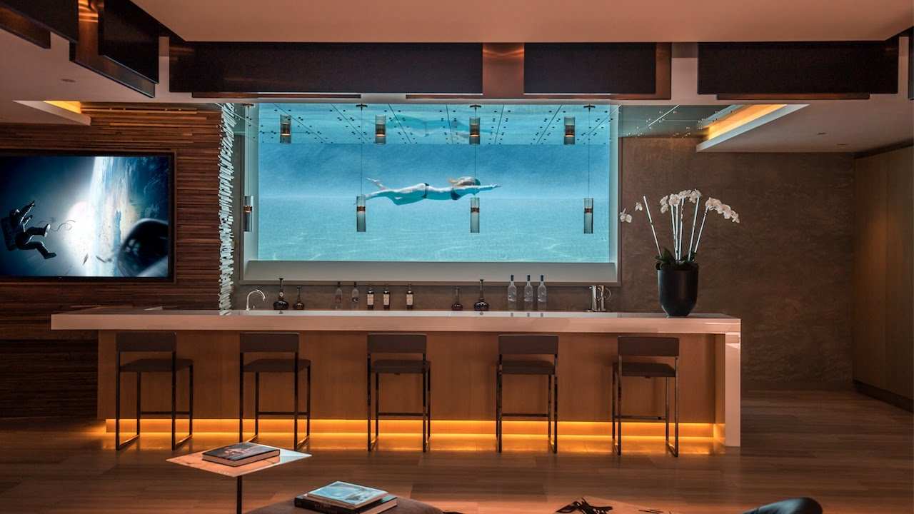 You are currently viewing Check out this amazing home and Pool – And the Wine Rack!!