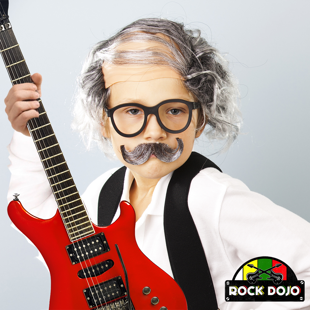 kid dressed up like an old man playing guitar