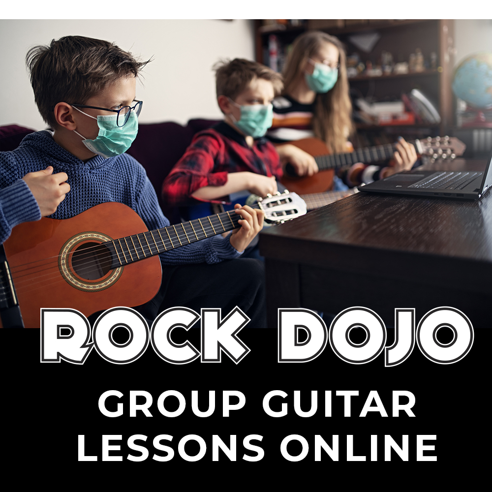 Group of kids taking guitar lessons online