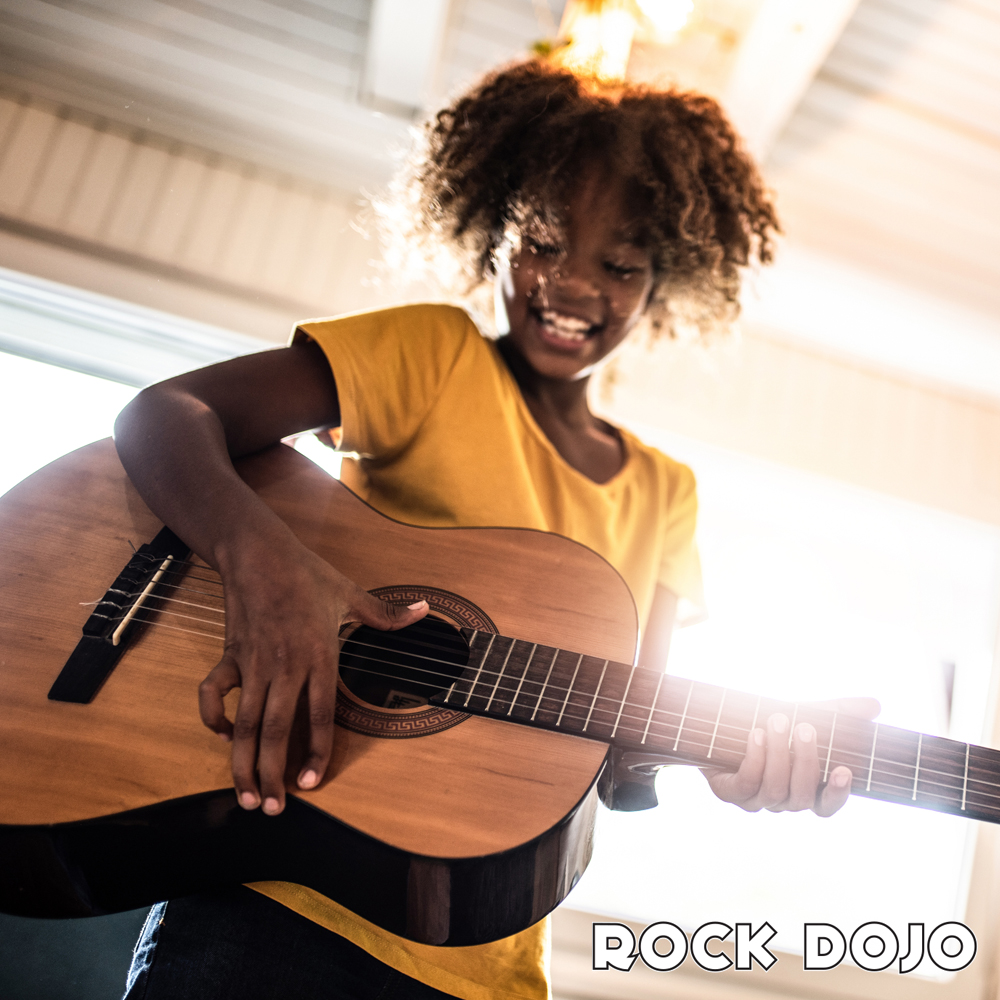 african american black girl playing and learning the guitar