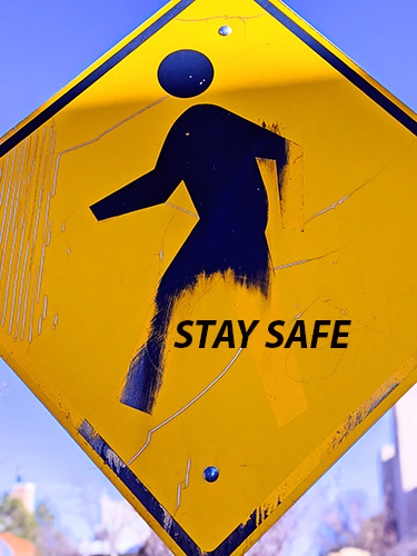 Stay Safe yellow sign