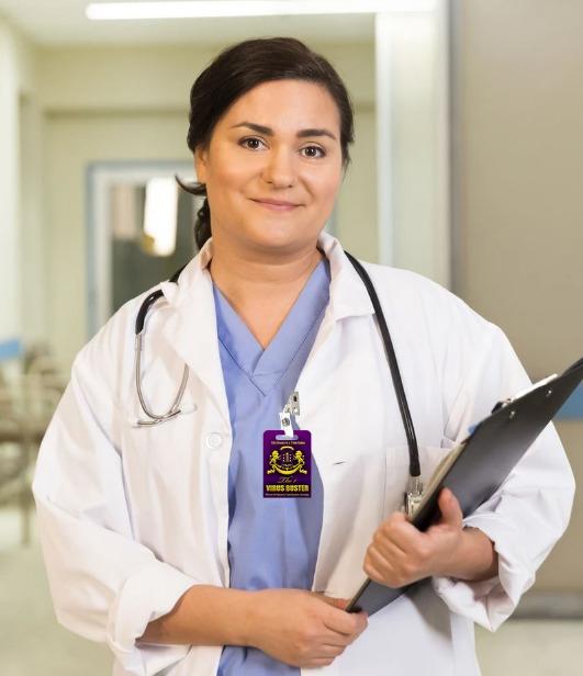 Nurse wearing the 1 virus buster badge