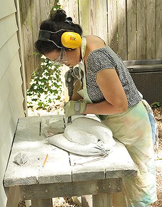 Art student carving a sculpture in atlanta stone sculpture class