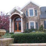stone veneer house with columns