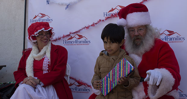 Homes 4 Families Hosts Holiday Party For Residents Of Center Pointe Community