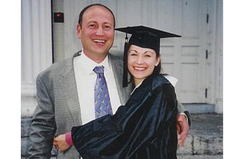Marijke with her dad at graduation