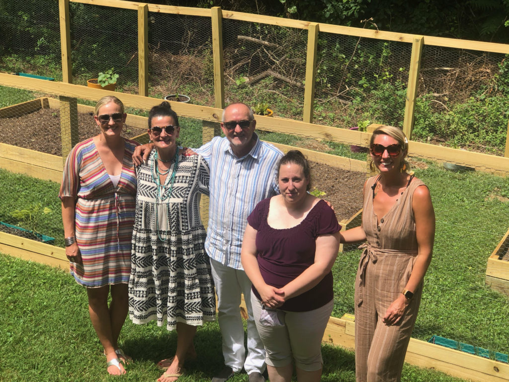 IHOH board members w/ Opening new doors foundation executive director, Talia outside Marijke's place. They put in a garden so the woman can have an additional space for growth & healing.
