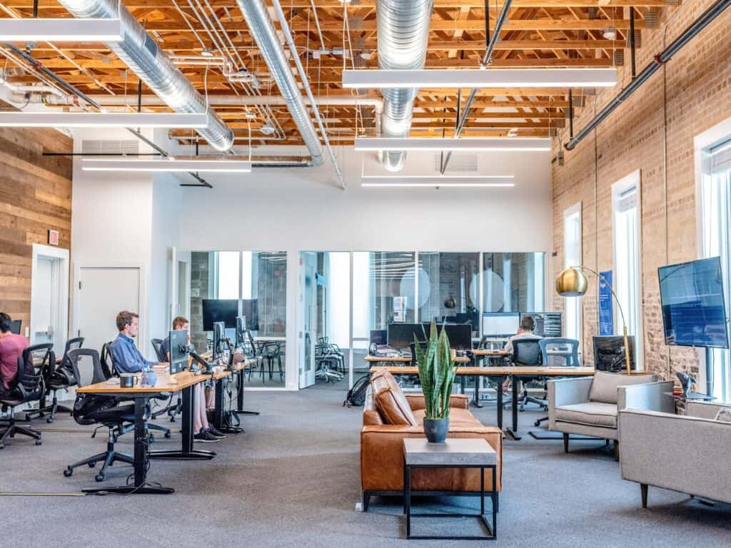 people working at their desks in a open concept office