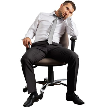 Lillie Chiropractic - Offering - Get The Most Out of You - Assets - man_tired_sitting_in_a_desktop_chair