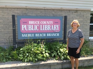 Maureen O'Shea in front of Sauble Beach Public Library