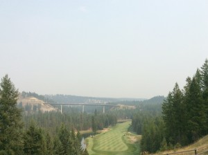 """The famous """"Monster"""" hole with smoke from the fires."""