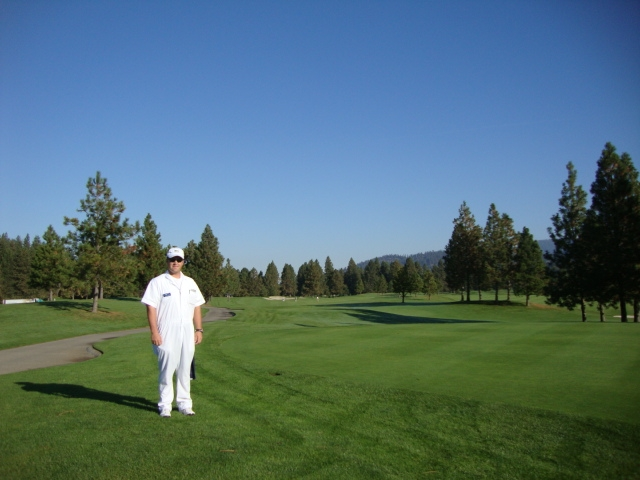 Josh our caddy. Teaches school throughout the year and caddies in the summer. White coveralls just like at the Masters!