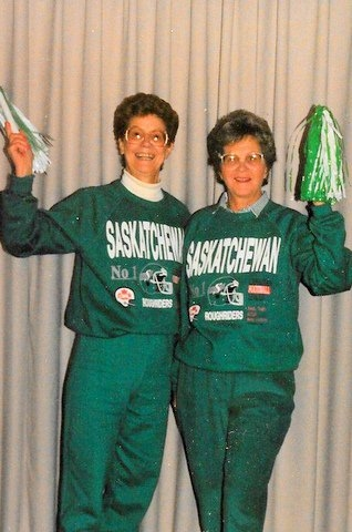 Marjorie and Maureen ready to cheer on the team.