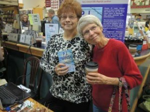 Kelly posing with our book HEART OF ICE and a very nice Horizon Books customer