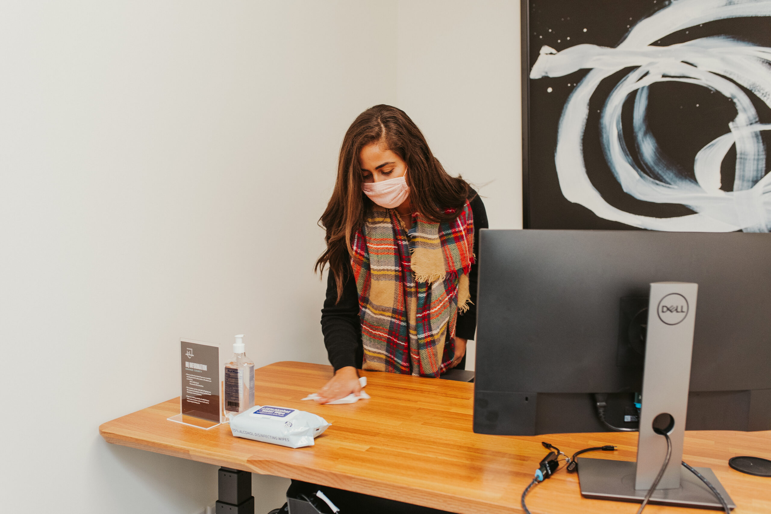 Justice HQ employee cleaning desk
