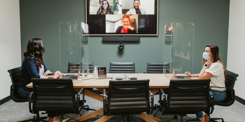 Justice HQ members meeting in conference room