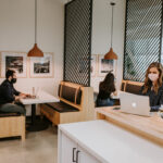 Justice HQ members working in DTLA café seating