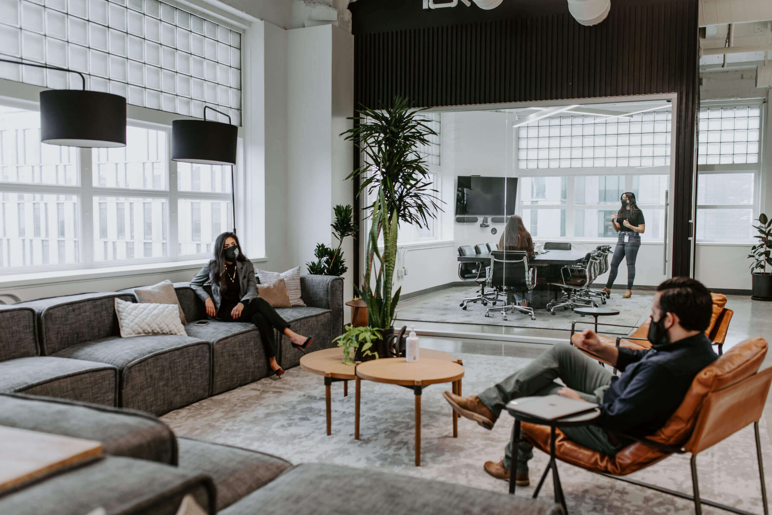 Justice HQ members in DTLA lounge and conference room