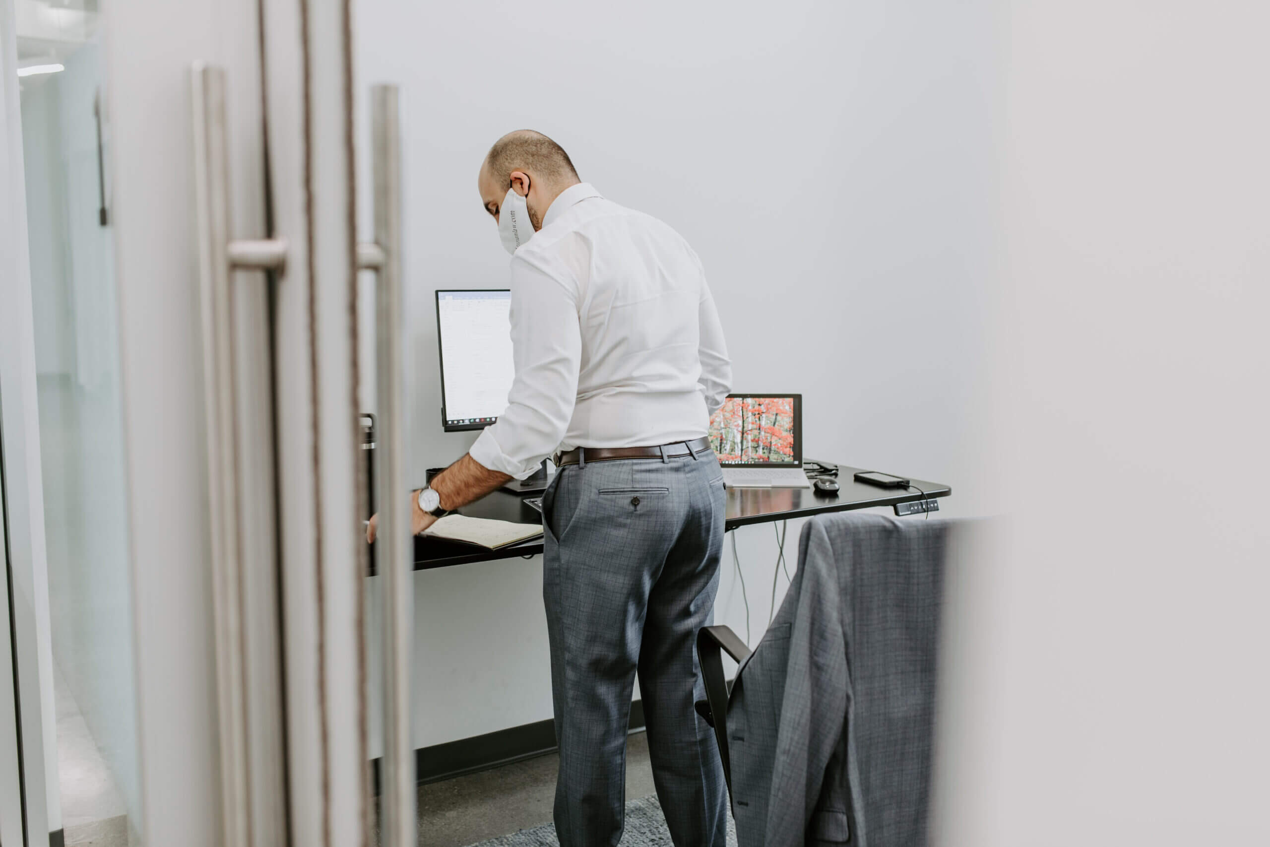 Justice HQ member working in a private office