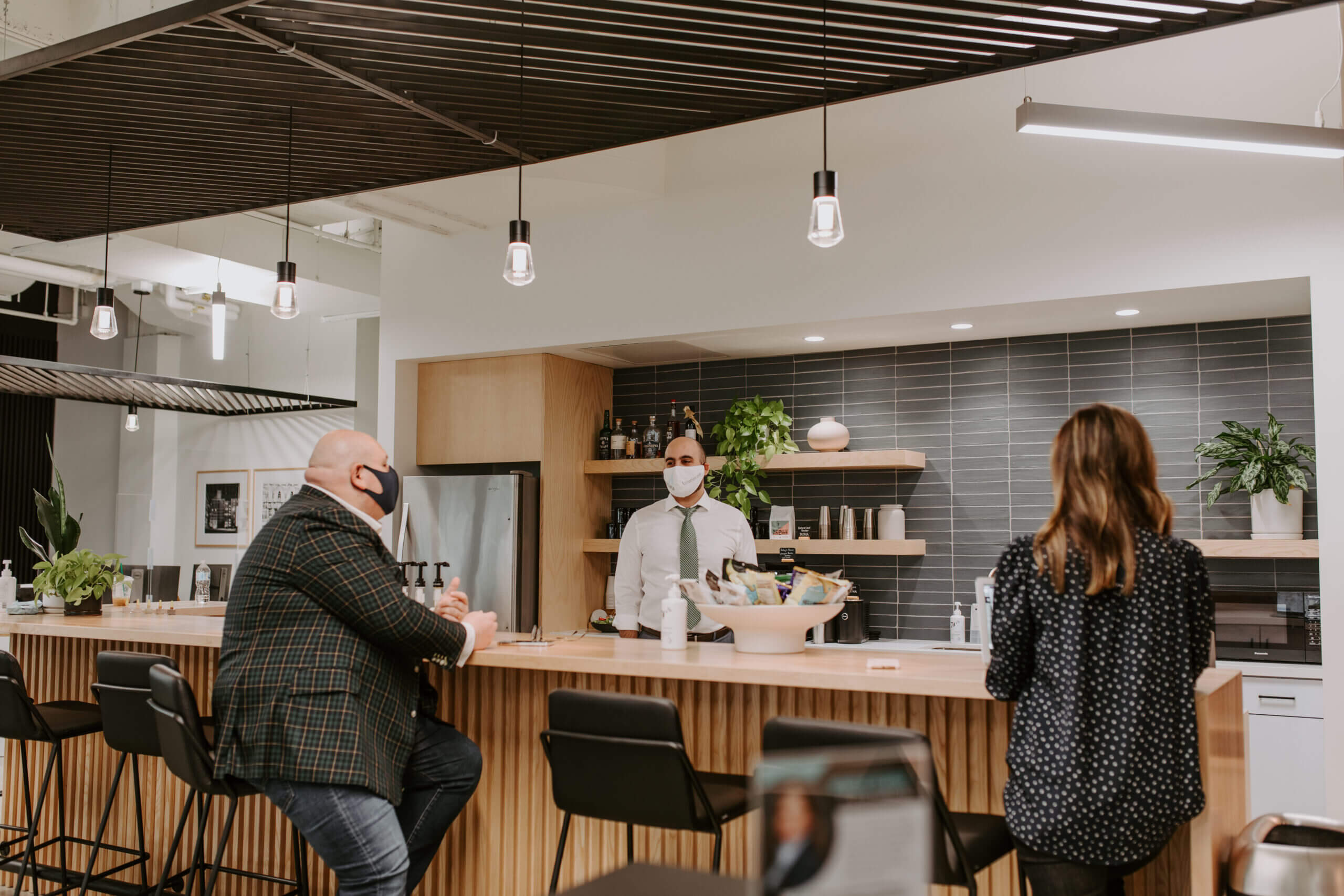 Justice HQ members talking in kitchen and bar area