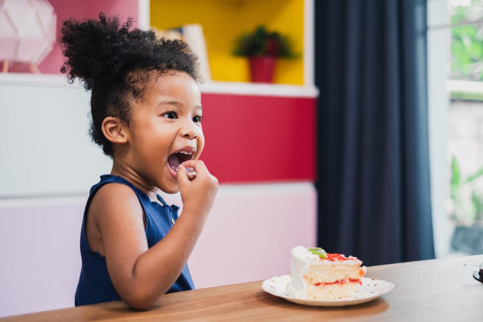 african girl kid eating sweet cake