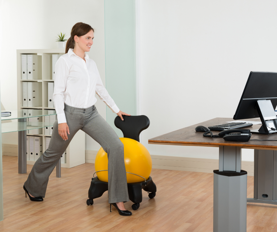 Woman exercising in office