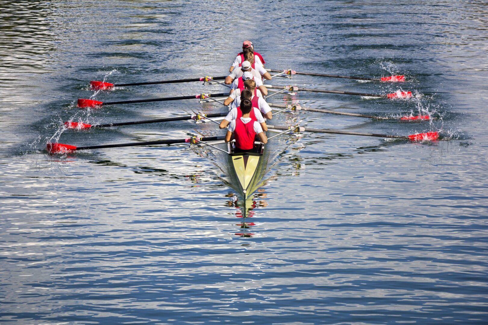 Rowers,In,Eight-oar,Rowing,Boats,On,The,Tranquil,Lake
