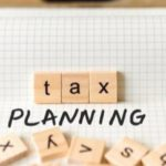 Scrabble pieces spelling out tax planning