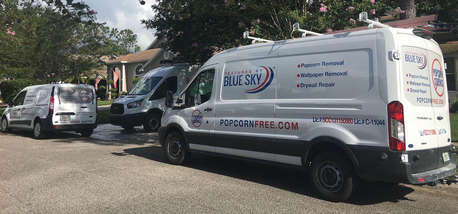 Vans in Front of House