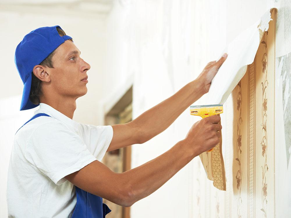 Worker Peeling Off Wallpaper