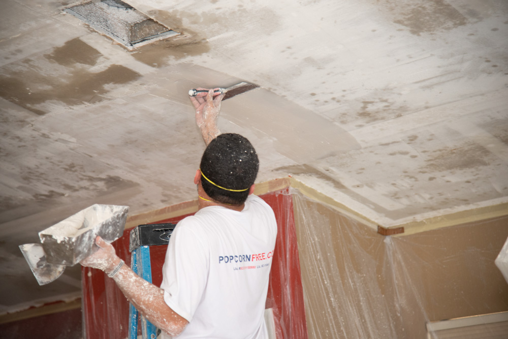 Spreading Drywall Compound on Ceiling