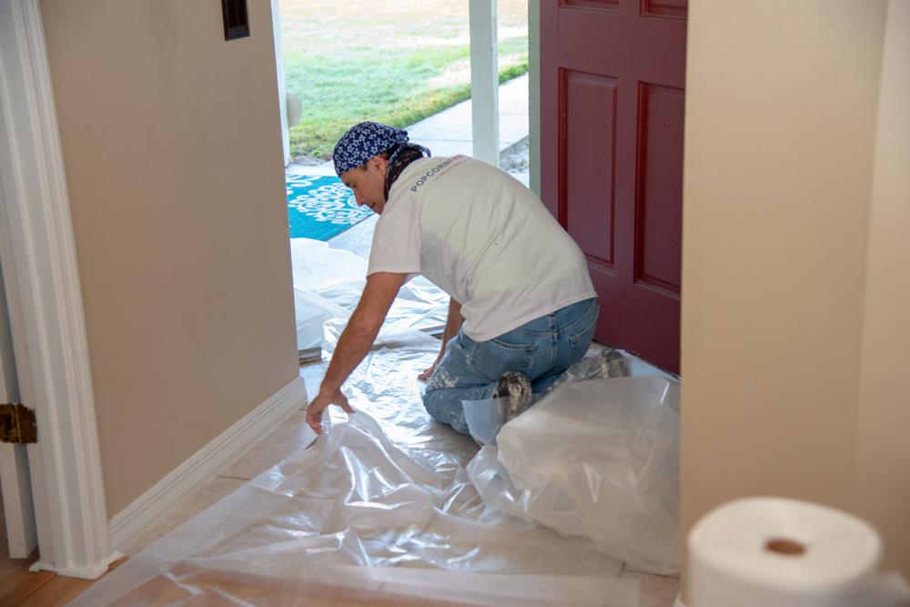 Employee Preparing Front Entrance