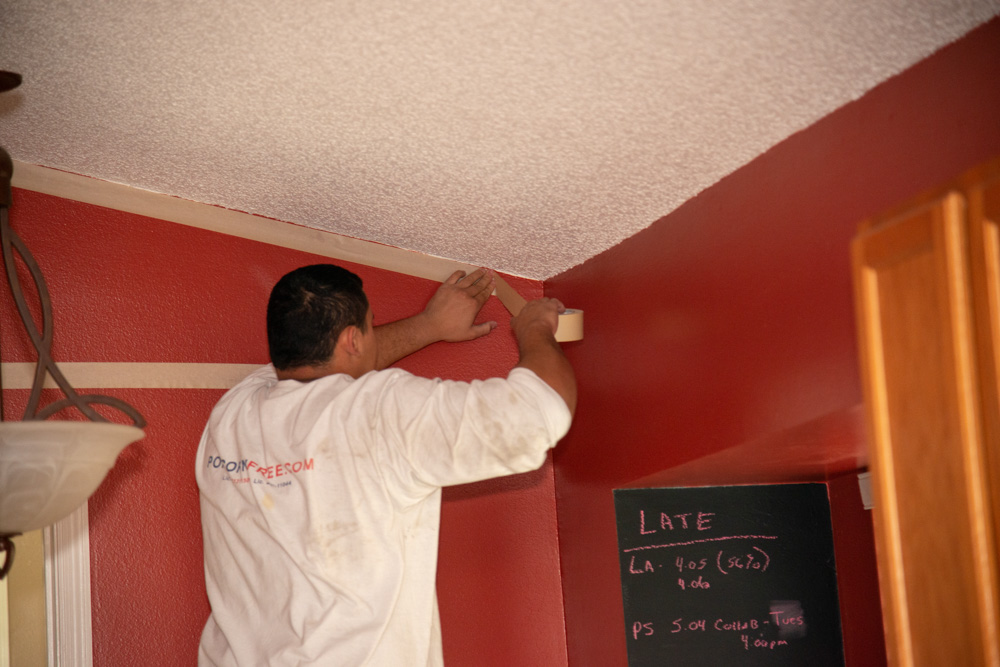 Worker Taping Ceiling
