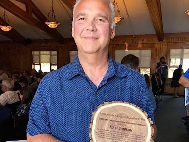 Matt Simpson with the distinguished waterway award