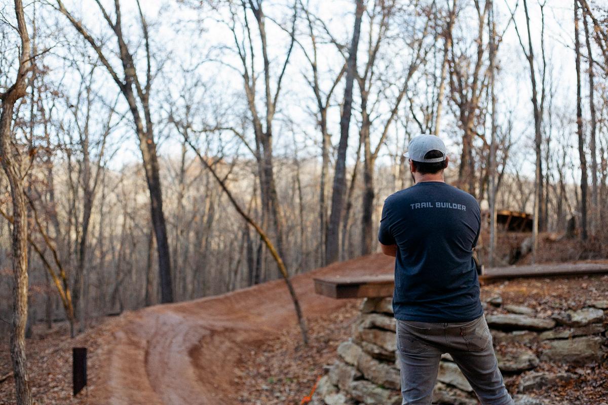 Trailbuilder looks over trail