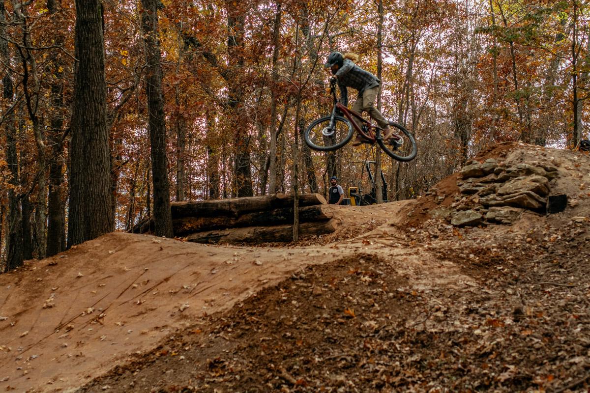 Rider jumping Progressive Trail Design trail in Bentonville Arkansas