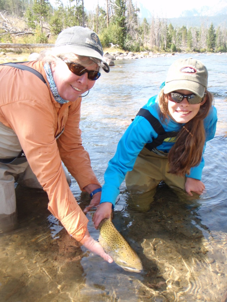 Releasing the jack salmon back to the river