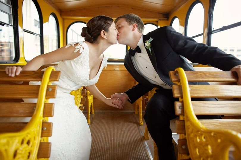 Bride Wedding Dress White Groom Black Tuxedo bow tie inside trolley philadelphia just married wedding day wood seats