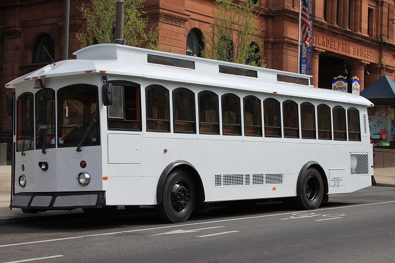 White Victorian Trolley Rental driving up to the Bourse Building for Special Day Service for Wedding Bride and Groom Summer time heading to Cescaphe ballroom Philadelphia