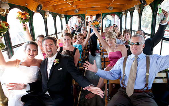 Wedding Party in Trolley Philadelphia Decorated Bride Groom Best Man Maid of Honor arms up Rental fowers