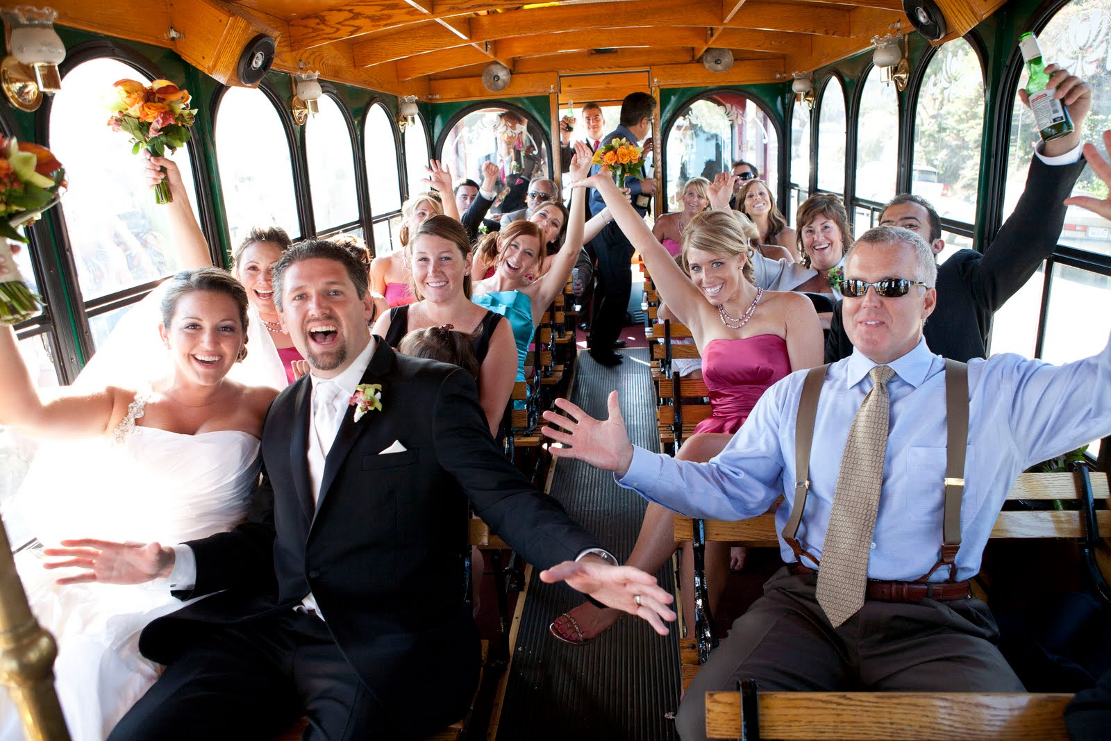 wedding party inside Victorian white trolley rental Philadelphia fun party bride groom dress suit glasses happy flowers