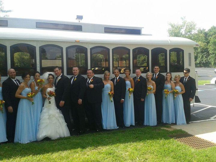 White Trolley Rental Philadelphia Wedding Party Bridemaids Grooms Men Best Man Bride Groom Red Yellow Flowers outside Transportation