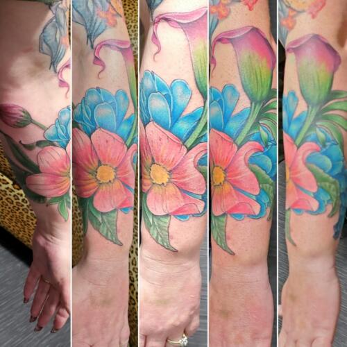 Tattoos by Tymm Cre8tions - womans floral sleeve tattoo