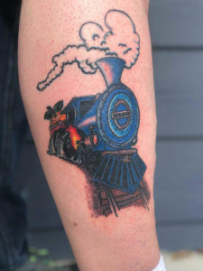 train tattoo by Dylan Llewellyn