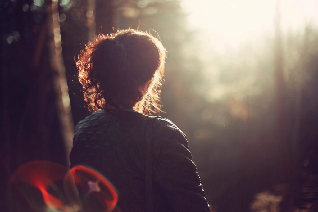 Girl looking into sunlight
