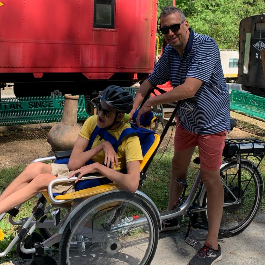 Dean with Bennett on Bike