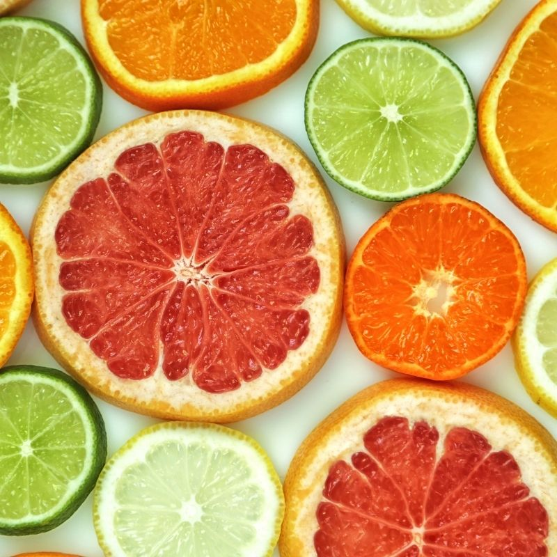 Citrus fruit sliced thin on a table.