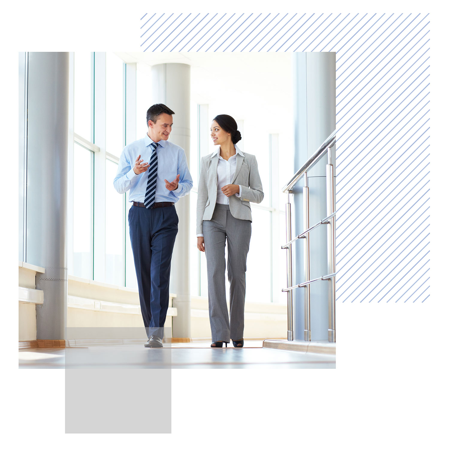 business colleagues walking down a hall in a modern office building